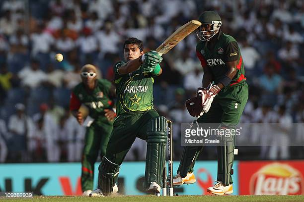 Umar Akmal of Pakistan hits to the onside as wicketkeeper Morris Ouma looks on during the Kenya v Pakistan 2011 ICC World Cup Group A match at the...
