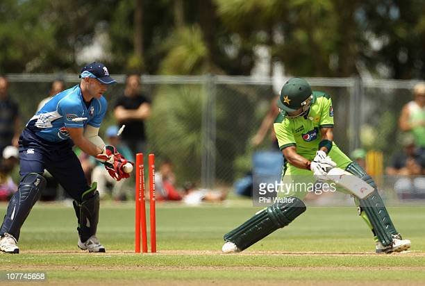 Umar Akmal of Pakistan is bowled by Roneel Hira of the Aces during the Twenty20 trial match between Pakistan and the Auckland Aces at Colin Maiden...