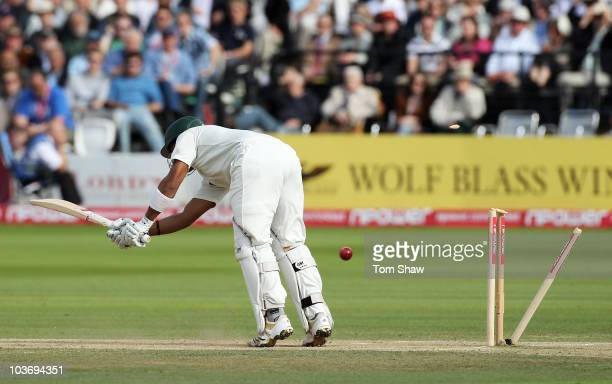 Umar Akmal of Pakistan is bowled by Steven Finn of England during day three of the 4th npower Test Match between England and Pakistan at Lord's on...