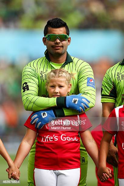 Umar Akmal of Pakistan looks on during the natioanl anthems at the 2015 ICC Cricket World Cup match between Pakistan and the West Indies at Hagley...