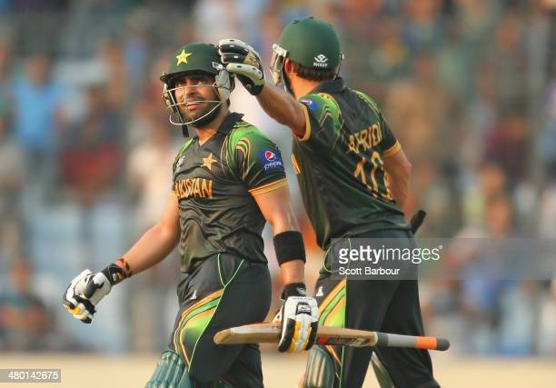 Umar Akmal of Pakistan reacts after being dismissed for 94 as Shahid Afridi congratulates him during the ICC World Twenty20 Bangladesh 2014 match...