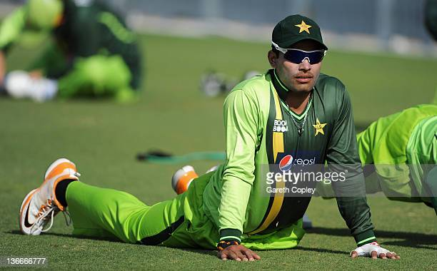 Umar Akmal of Pakistan stretches during a nets session at the ICC Global Academy on January 10 2012 in Dubai United Arab Emirates