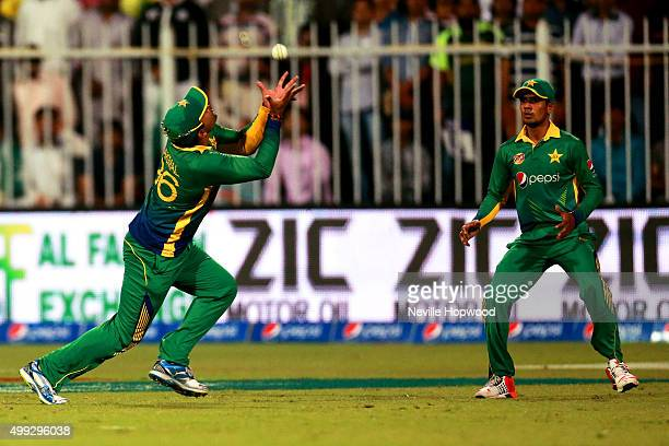Umar Akmal of Pakistan takes the catch to dismiss James Vince of England during the 3rd International T20 match between Pakistan and England at...