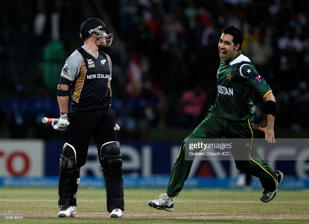 Umar Gul of Pakistan celebrates after bowling Brendon McCullum (L) of New Zealand during the ICC World T20 Group D match between New Zealand and Pakistan at Pallekele Cricket Stadium on September 23, 2012 in Kandy, Sri Lanka.