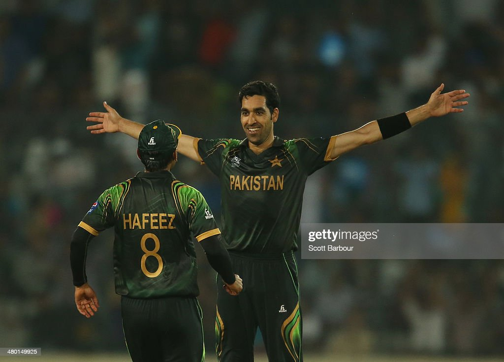 Umar Gul of Pakistan celebrates after dismissing Brad Hodge of Australia during the ICC World Twenty20 Bangladesh 2014 match between Australia and Pakistan at Sher-e-Bangla Mirpur Stadium on March 23, 2014 in Dhaka, Bangladesh.
