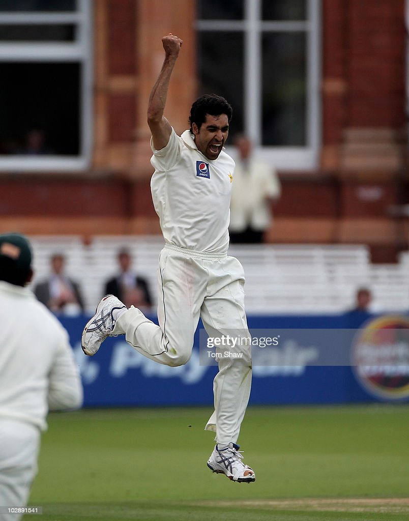 Umar Gul of Pakistan celebrates taking the wicket of Mike Hussey of Australia during day two of the First Test between Pakistan and Australia at Lords on July 14, 2010 in London, England.