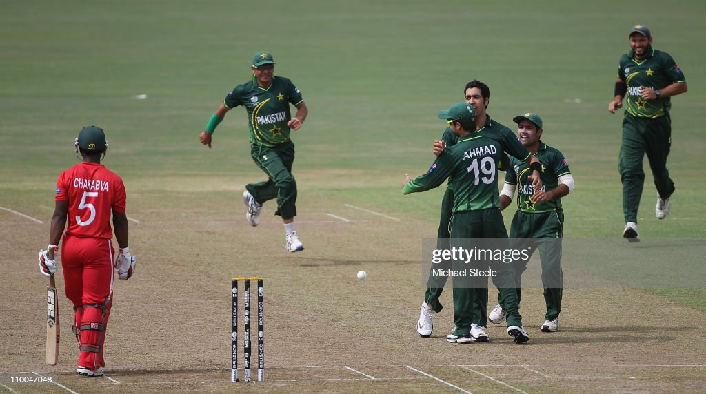 Umar Gul (4R) of Pakistan celebrates taking the wicket of Regis Chakabva (L) during the Pakistan v Zimbabwe 2011 ICC World Cup Group A match at the Pallekele Cricket Stadium on March 14, 2011 in Kandy, Sri Lanka.