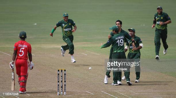 Umar Gul of Pakistan celebrates taking the wicket of Regis Chakabva during the Pakistan v Zimbabwe 2011 ICC World Cup Group A match at the Pallekele...