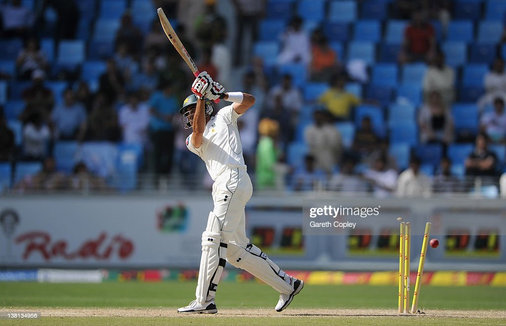 <a gi-track='captionPersonalityLinkClicked' href=/galleries/search?phrase=Umar+Gul&family=editorial&specificpeople=540300 ng-click='$event.stopPropagation()'>Umar Gul</a> of Pakistan is bowled by James Anderson of England during the 3rd Test match between Pakistan and England at The Dubai International Cricket Stadium on February 3, 2012 in Dubai, United Arab Emirates.