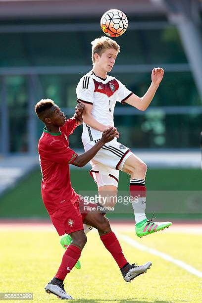 Umaro Embalo of Portugal challenges Jan Boller of Germany during the UEFA Under16 match between U16 Portugal v U16 Germany on February 4 2016 in Vila...