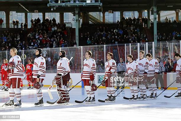 UMass during the national anthem before a Frozen Fenway NCAA Men's Division 1 hockey game between the Boston University Terriers and the University...