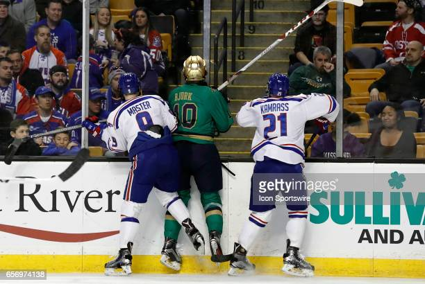 UMass Lowell River Hawks center Nick Master and UMass Lowell River Hawks left wing Jake Kamrass team up to stop Notre Dame Fighting Irish right wing...
