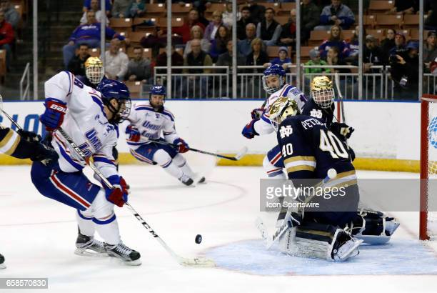 UMass Lowell River Hawks center Ryan Lohin can't get the tip past Notre Dame Fighting Irish goaltender Cal Petersen during the NCAA Northeast...