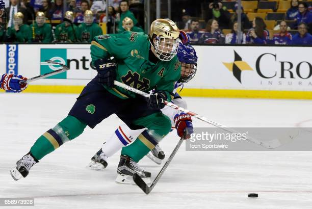 UMass Lowell River Hawks defenseman Mattias Goransson tries to stop Notre Dame Fighting Irish right wing Anders Bjork during a Hockey East semifinal...