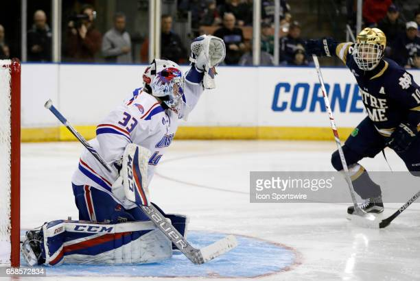UMass Lowell River Hawks goaltender Tyler Wall makes a stop as Notre Dame Fighting Irish right wing Anders Bjork looks for a rebound during the NCAA...