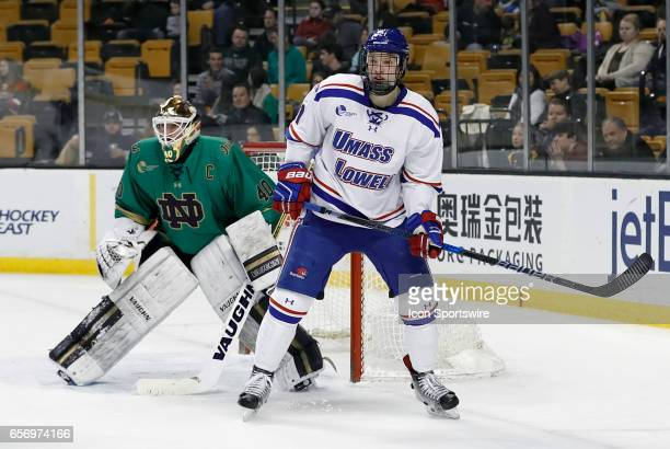 UMass Lowell River Hawks left wing Jake Kamrass sets up to the left of Notre Dame Fighting Irish goaltender Cal Petersen on the power play during a...