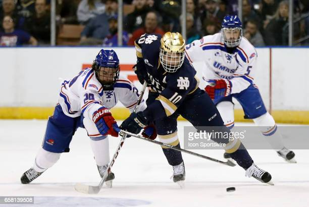 UMass Lowell River Hawks right wing John Edwardh tries to stop Notre Dame Fighting Irish right wing Anders Bjork during the NCAA Northeast Regional...