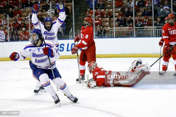UMass Lowell River Hawks right wing Ryan Dmowski reacts to his goal during an NCAA Northeast Regional semifinal between the UMass Lowell River Hawks...