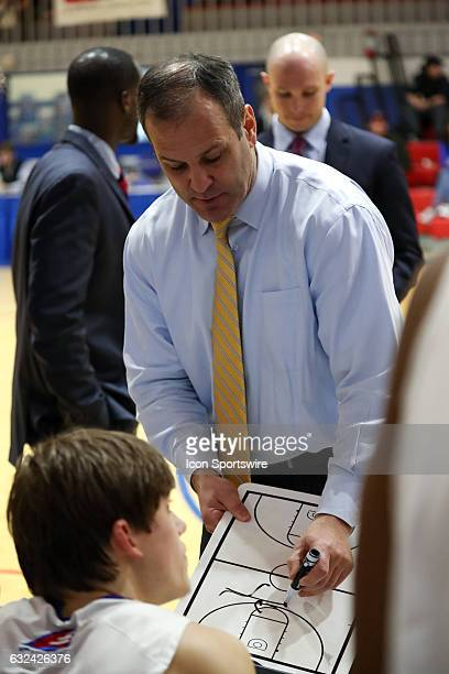 UMass Lowell Riverhawks head coach Pat Duquette sketches out a play during a timeout in the second half of the game between the UMBC Retrievers and...