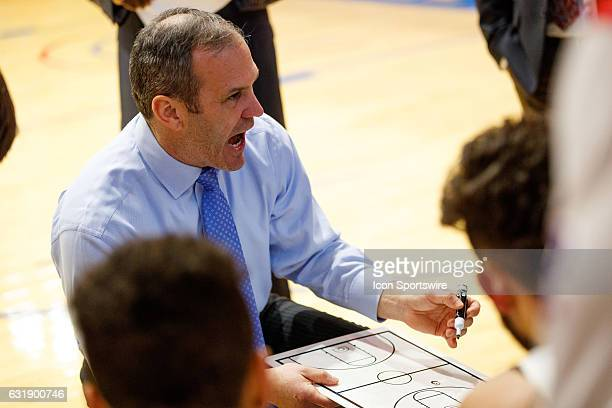 UMass Lowell Riverhawks head coach Pat Duquette sketches out tactics during a timeout in the second half of the game between the UMass Lowell...
