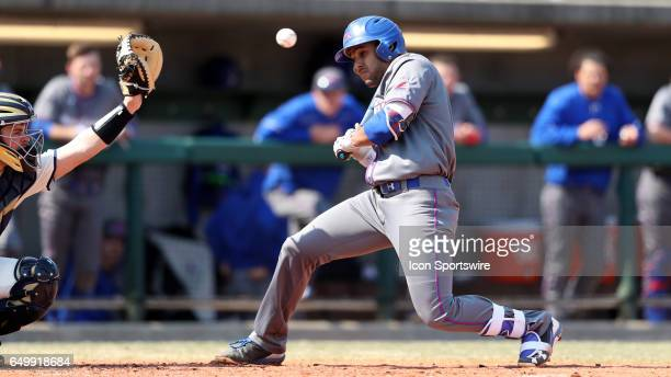 UMass Lowell's Oscar Marchena ducks out of the way of an inside pitch The University of Massachusetts Lowell River Hawks played the University of...