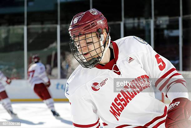 UMass Minutemen defenseman Callum Fryer skates during warm up before a Frozen Fenway NCAA Men's Division 1 hockey game between the Boston University...