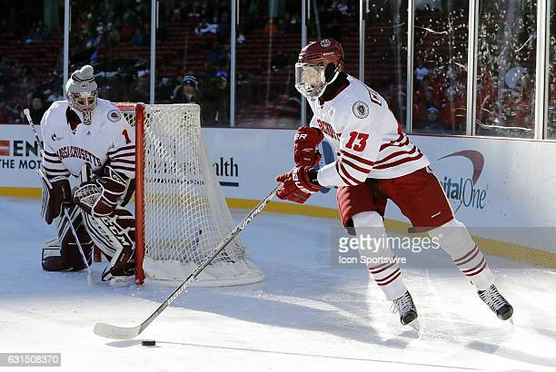 UMass Minutemen defenseman Ivan Chukarov starts a rush up ice during a Frozen Fenway NCAA Men's Division 1 hockey game between the Boston University...
