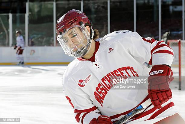UMass Minutemen defenseman Jake Horton skates during warm up before a Frozen Fenway NCAA Men's Division 1 hockey game between the Boston University...