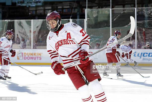 UMass Minutemen defenseman William Lagesson skates during warm up before a Frozen Fenway NCAA Men's Division 1 hockey game between the Boston...
