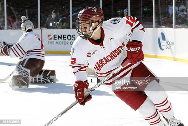 UMass Minutemen forward Michael Iovanna skates during warm up before a Frozen Fenway NCAA Men's Division 1 hockey game between the Boston University...