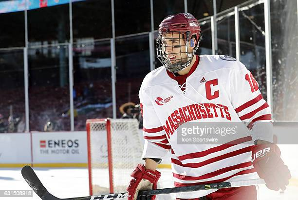 UMass Minutemen forward Steven Iacobellis skates during warm up before a Frozen Fenway NCAA Men's Division 1 hockey game between the Boston...