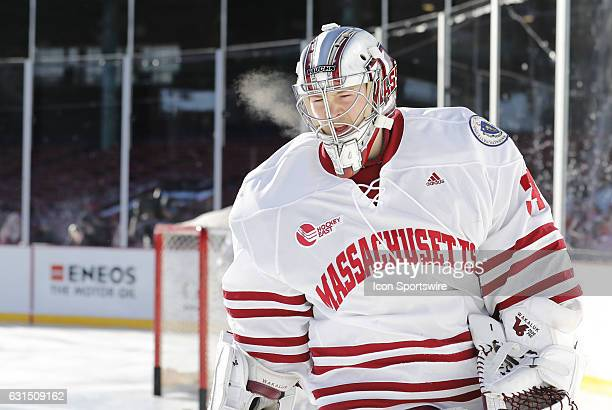 UMass Minutemen goaltender Alex Wakaluk skates during warm up before a Frozen Fenway NCAA Men's Division 1 hockey game between the Boston University...