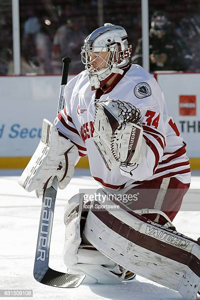 UMass Minutemen goaltender Alex Wakaluk warms up before a Frozen Fenway NCAA Men's Division 1 hockey game between the Boston University Terriers and...