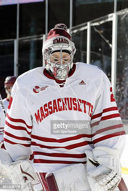 UMass Minutemen goaltender Nic Renyard skates during warm up before a Frozen Fenway NCAA Men's Division 1 hockey game between the Boston University...