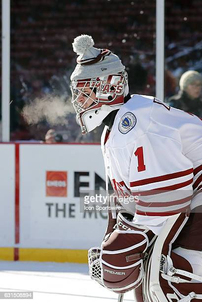 UMass Minutemen goaltender Ryan Wischow exhales on a frosty day during a Frozen Fenway NCAA Men's Division 1 hockey game between the Boston...