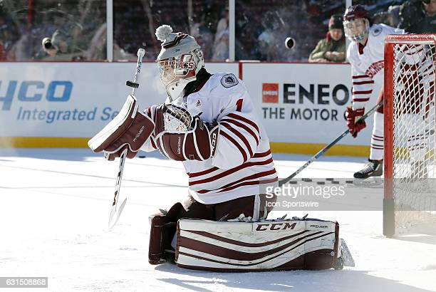 UMass Minutemen goaltender Ryan Wischow eyes a save in warm up before a Frozen Fenway NCAA Men's Division 1 hockey game between the Boston University...