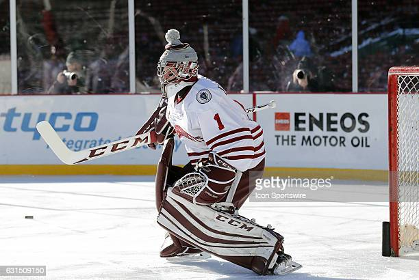 UMass Minutemen goaltender Ryan Wischow warms up before a Frozen Fenway NCAA Men's Division 1 hockey game between the Boston University Terriers and...