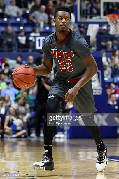 UMass Minutemen guard CJ Anderson brings the ball up court during the second half of an NCAA basketball game between UMass Minutemen and Rhode Island...