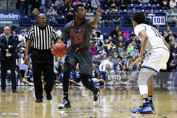 UMass Minutemen guard CJ Anderson directs the offense while defended by Rhode Island Rams guard Jeff Dowtin during the second half of an NCAA...