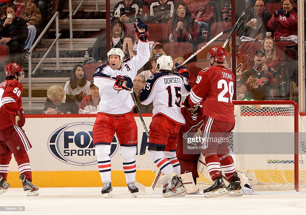 R.J. Umberger #18 of the Columbus Blue Jackets celebrates a second-period goal against the Phoenix Coyotes at Jobing.com Arena on January 23, 2013 in Glendale, Arizona.