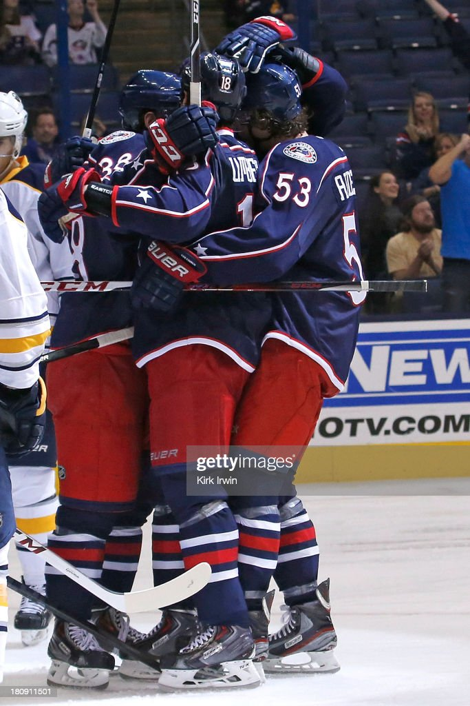 R.J. Umberger #18 of the Columbus Blue Jackets is congratulated by his teammates after scoring a goal during the second period against the Buffalo Sabres on September, 2013 at Nationwide Arena in Columbus, Ohio.