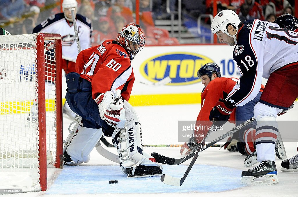 J Umberger of the Columbus Blue Jackets scores the game winning goal in overtime against Jose Theodore of the Washington Capitals at the Verizon...