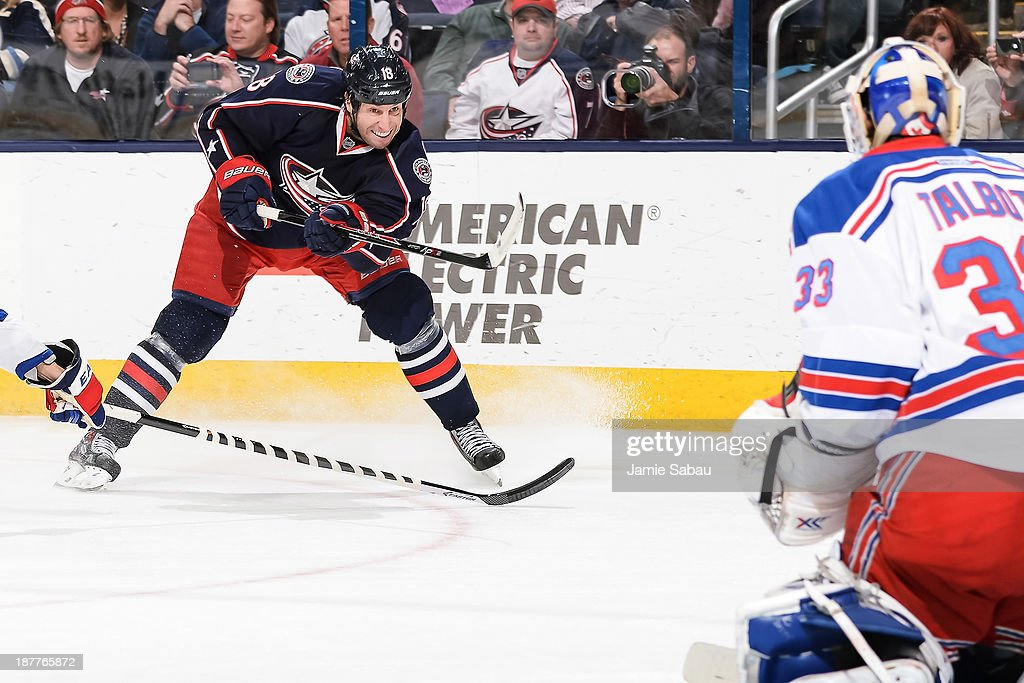 R.J. Umberger #18 of the Columbus Blue Jackets skates with the puck against the New York Rangers on November 7, 2013 at Nationwide Arena in Columbus, Ohio.