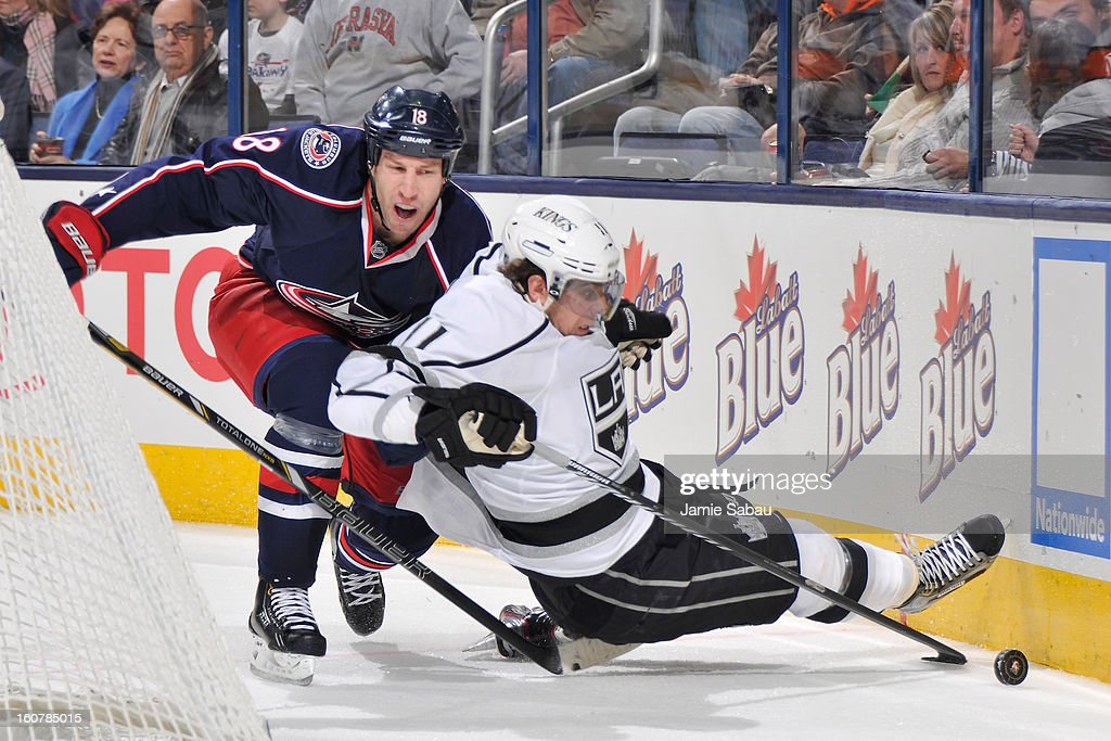 R.J. Umberger #18 of the Columbus Blue Jackets trips <a gi-track='captionPersonalityLinkClicked' href=/galleries/search?phrase=Anze+Kopitar&family=editorial&specificpeople=634911 ng-click='$event.stopPropagation()'>Anze Kopitar</a> #11 of the Los Angeles Kings in the third period on February 5, 2013 at Nationwide Arena in Columbus, Ohio. Los Angeles defeated Columbus 4-2.