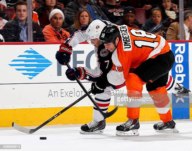 J Umberger of the Philadelphia Flyers and Jack Johnson of the Columbus Blue Jackets fight for the puck on November 14 2014 at the Wells Fargo Center...