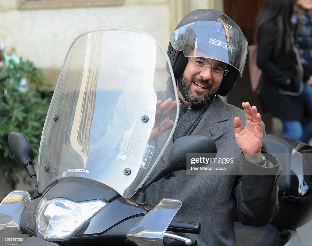 Umberto Ambrosoli arrives on a moped for a press conference on November 21, 2012 in Milan, Italy. Umberto Ambrosoli is candidate with PD (Democratic Party) for the next Lombardy Regional election