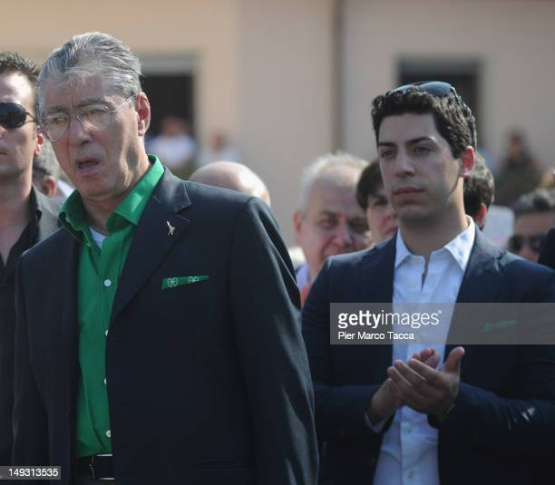 Umberto Bossi and Renzo Bossi attend the funeral of Cesarino Monti on July 26 2012 in Lazzate near Monza Italy