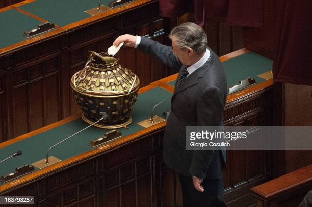 Umberto Bossi former leader of Lega Party places the ballot during the second meeting of the new Italian parliament at the Chamber of Deputies on...