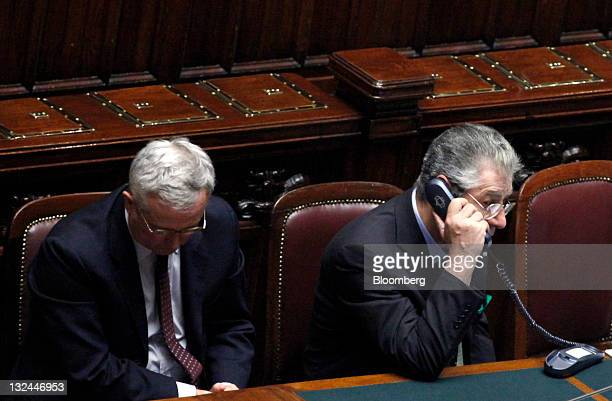 Umberto Bossi leader of Italy's Northern League party right talks on the phone as Giulio Tremonti Italy's finance minister looks down ahead of voting...