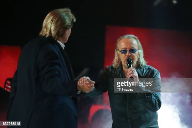 Umberto Tozzi Howard Carpendale perform during the taping of the show 'Schlagerboom Das Internationale Schlagerfest' at Westfalenhalle on October 21...